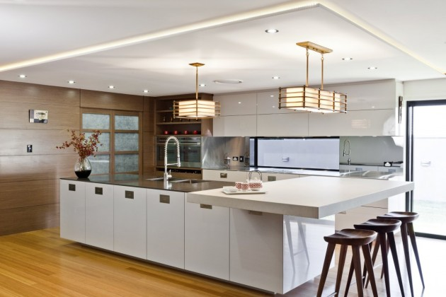 This photo shows a contemporary custom kitchen finished in popular white paint.