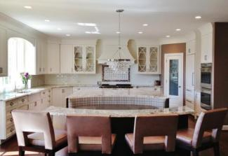 Banquette in this  kitchen remodel provides versatility of custom cabinetry