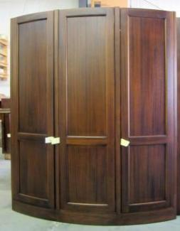 Massive curved front tall cabinet shows the design versatility of custom cabinetry