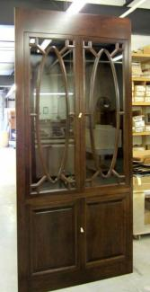Oval mullion doors and fluted pantry fronts show the design versatility of custom cabinetry.