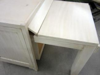 Pull Out table illustrates the design versatility of custom cabinetry.
