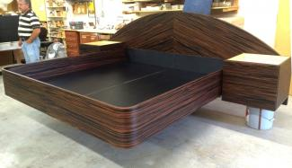 "Custom cabinetry used to create this amazing ""floating"" bed."