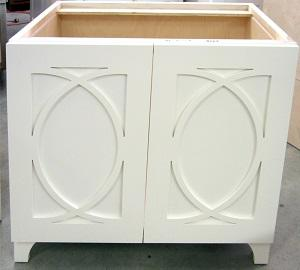 Fishtail mullion shapes on this vanity illustrate the design versatility of custom cabinetry