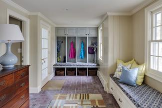 A bench seat is a necessity for a modern mudroom.