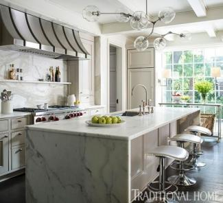 Excellent example of beautiful marble countertops with popular waterfall treatment.